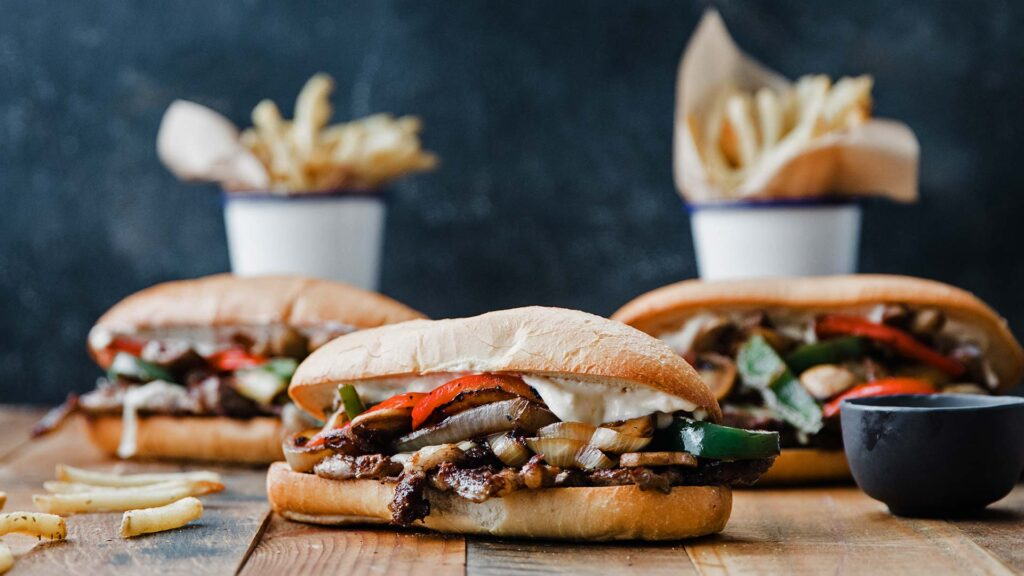 ribeye steak sandwiches with fries