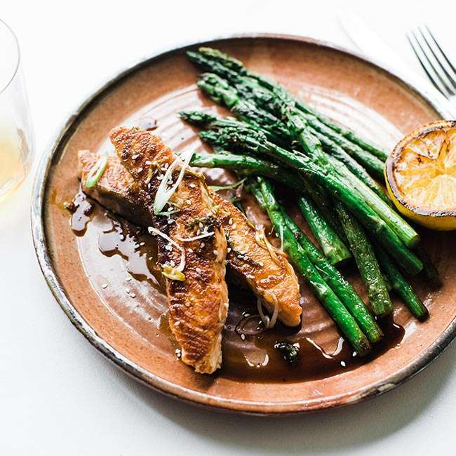 bourbon glazed salmon with a side of grilled asparagus