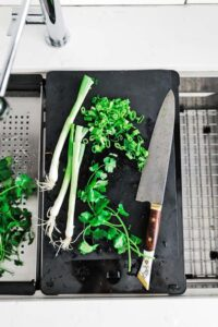 chopping herbs on the frank chef center cutting board attachment