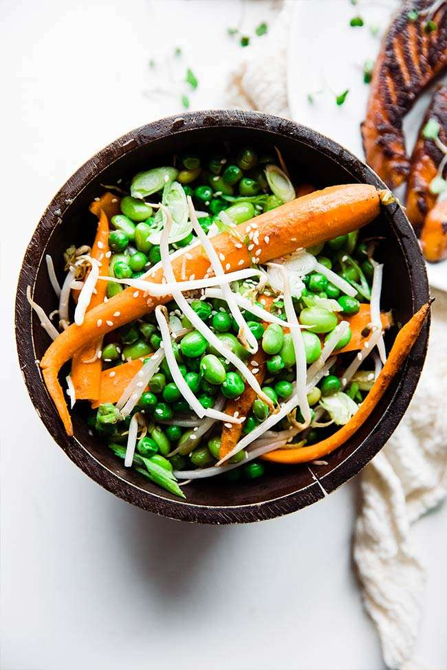 sauteed vegetables with baby carrots, edamame, peas and sprouts