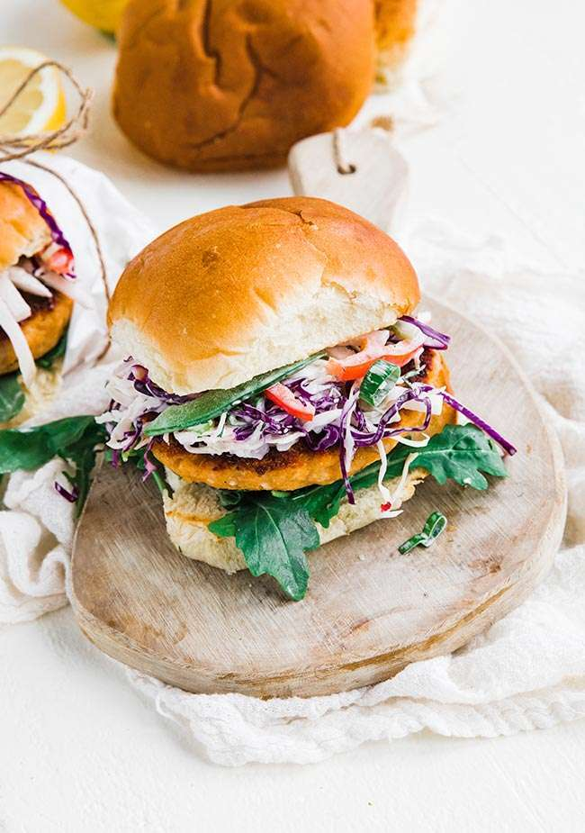 How to Make Salmon Burgers - learn how easy it is to make salmon burgers that are jam packed with flavor and served u with an amazing coleslaw on a toasted bun! #salmon #salmonercipes #salmonpatties #salmoncakes #burger #burgerrecipes #grilledsalmon #seafood #seafoodrecipes #coleslaw #coleslawrecipe