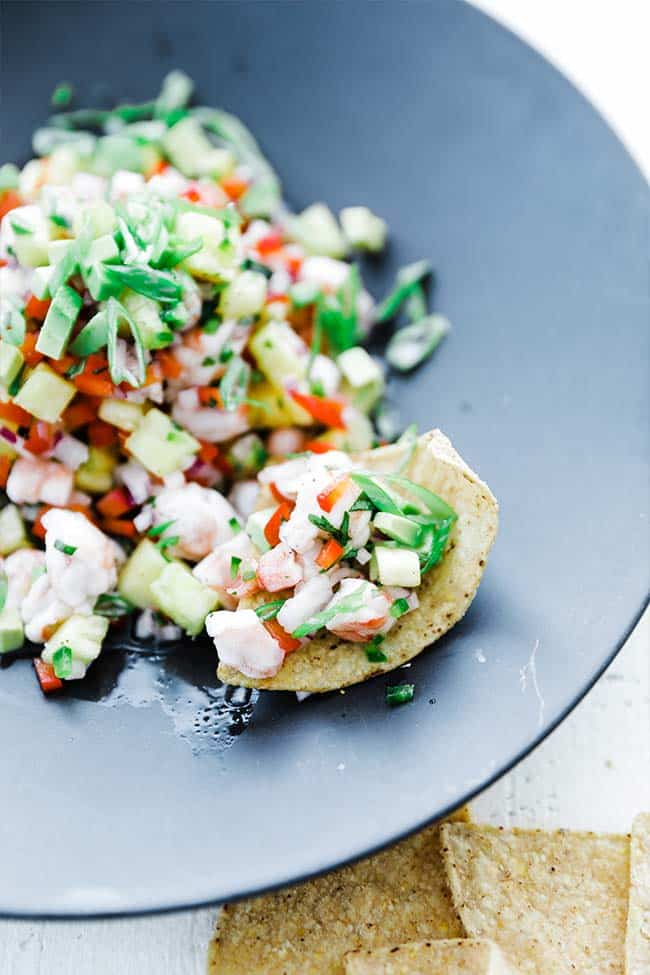 shrimp ceviche with green onions, pineapple and peppers served with tortilla chips