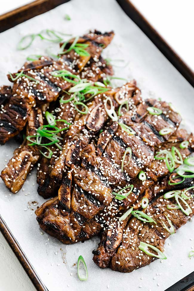grilled kalbi with sesame seeds and green onions