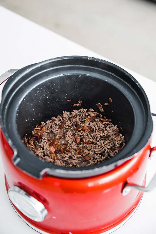 cooking the ground beef in a slow cooker for beer cheese dip