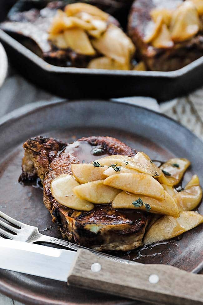 bone in pork chop with sliced cooked apples