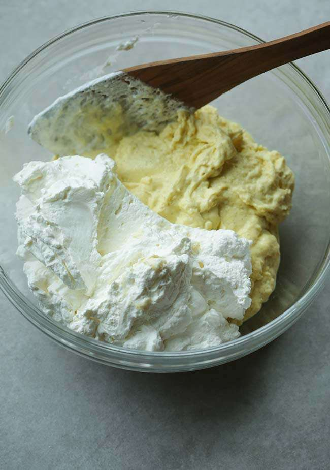 mixing the anglaise with the whipped cream to make bavarian cream