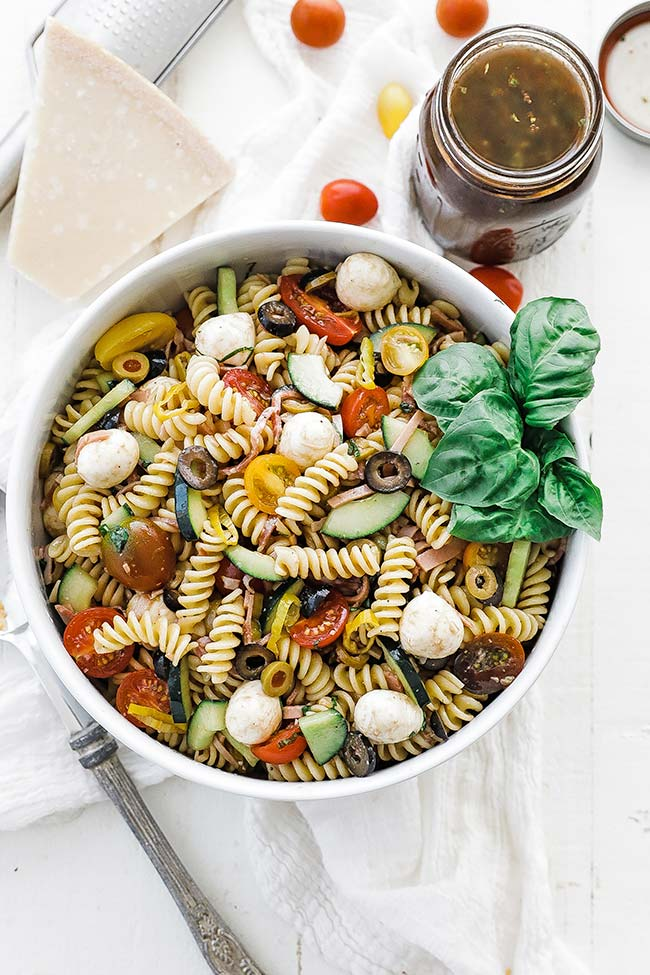 homemade pasta salad with tomatoes, herbs, cheese, and balsamic vinaigrette