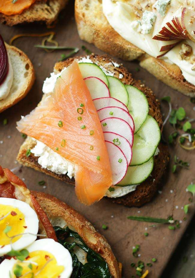 Smoked salmon with cucumbers, radishes and whipped cream cheese toast