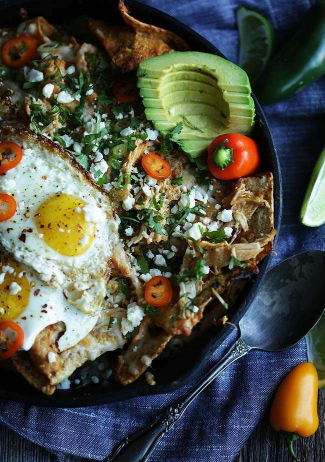 avocado and fried eggs in a chilaquiles for breakfast