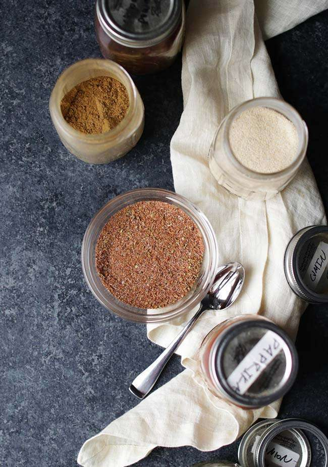 spices in a jar to make a rub for spicy salmon