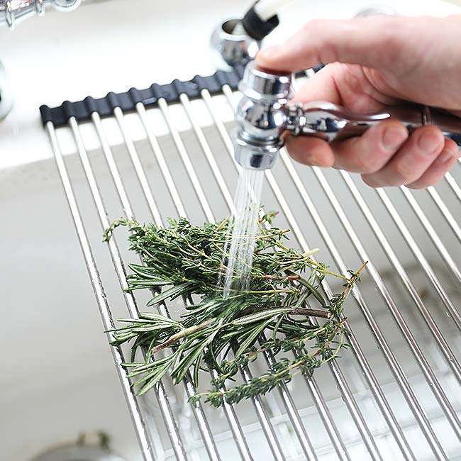 cleaning herbs for a New York Strip Steak Recipe
