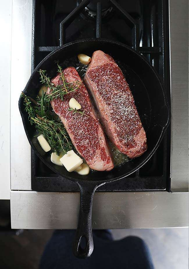 cooking a New York Strip Steak Recipe in a cast iron skillet