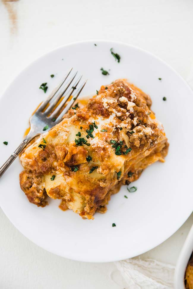 a slice of lasagna with bechamel and bolognese meat sauce