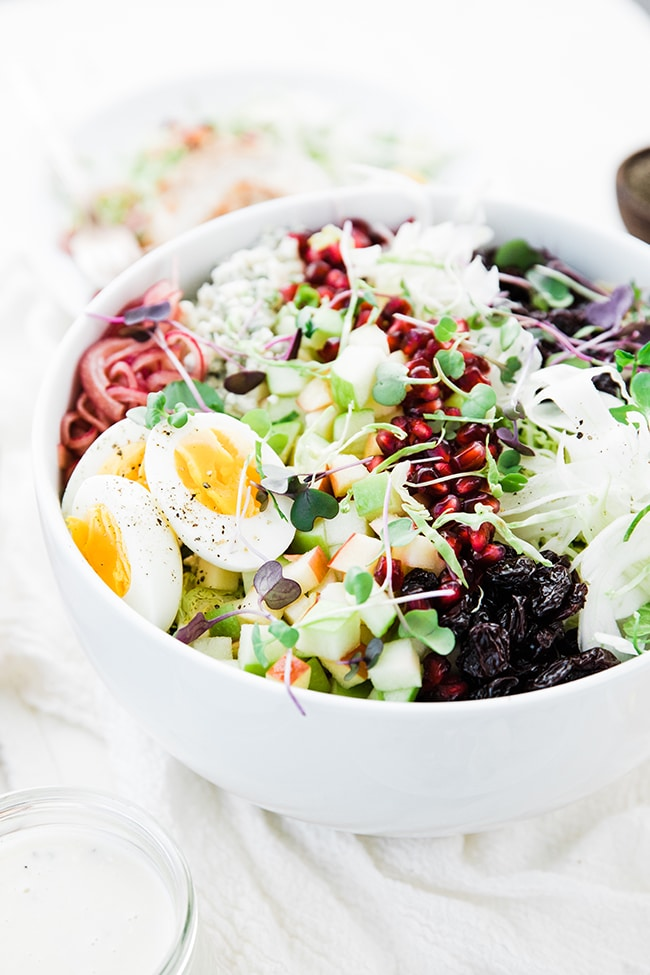 shaved brussel sprout salad with hard boiled eggs and fruit
