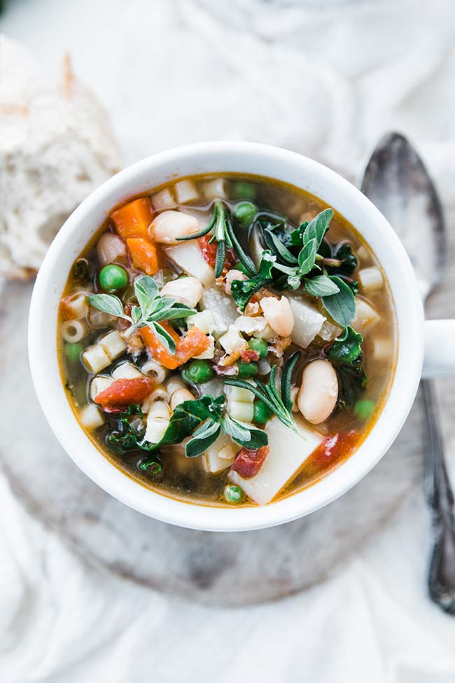minestrone soup recipe in a bowl served up with fresh herbs