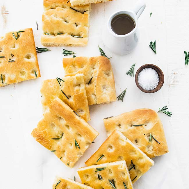 focaccia bred slices cut up with rosemary and olive oil