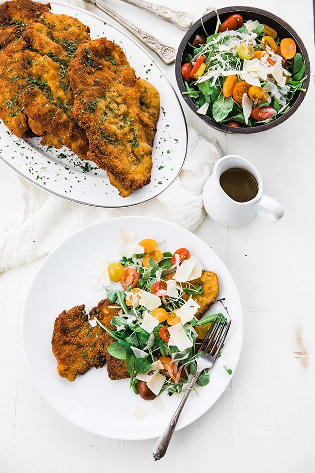 salad with fried chicken cutlets and a homemade salad dressing