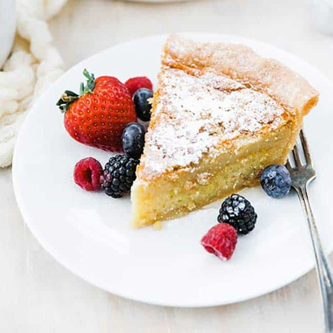 chess pie recipe on a plate with fresh berries