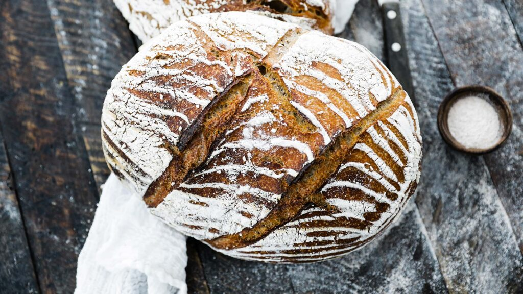 top down picture of a graham wheat flour bread recipe with dusting of flour