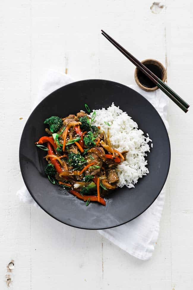 plate of chinese beef stir fry with white rice
