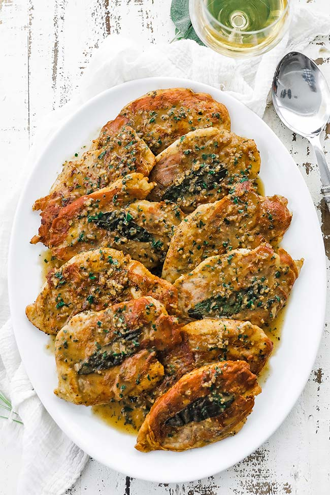 chicken saltimbocca with white wine sauce on a platter