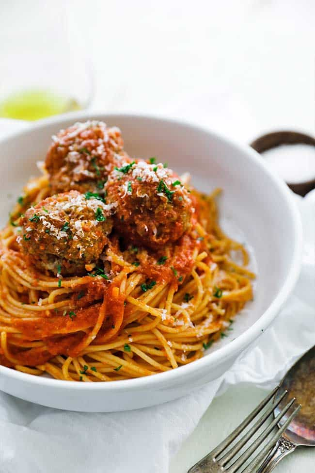 noodles coated in a pomodoro sauce with meatballs on top