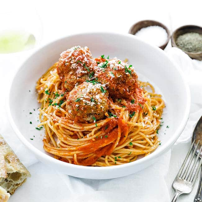 bowl of spaghetti with tomato sauce and meatballs