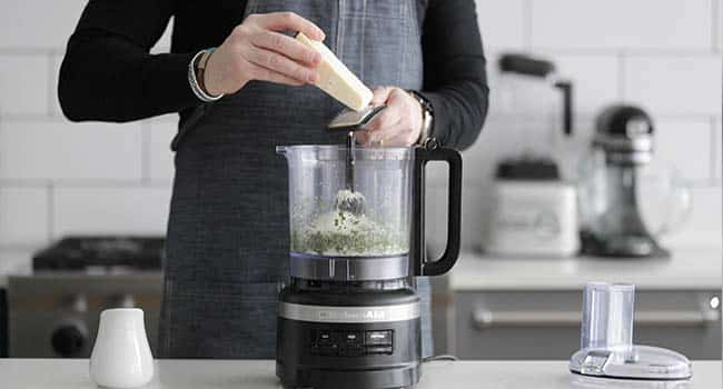 adding cheese to a food processor
