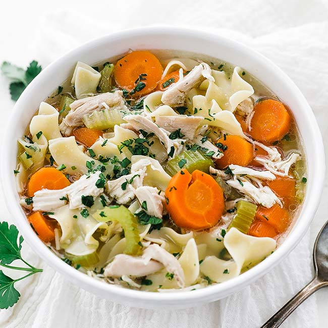 bowl of chicken noodle soup with vegetables