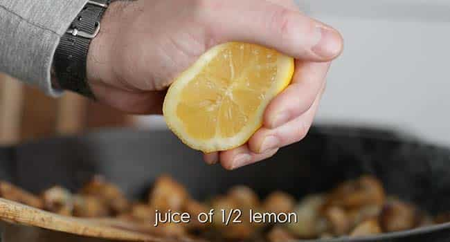squeezing a lemon into food