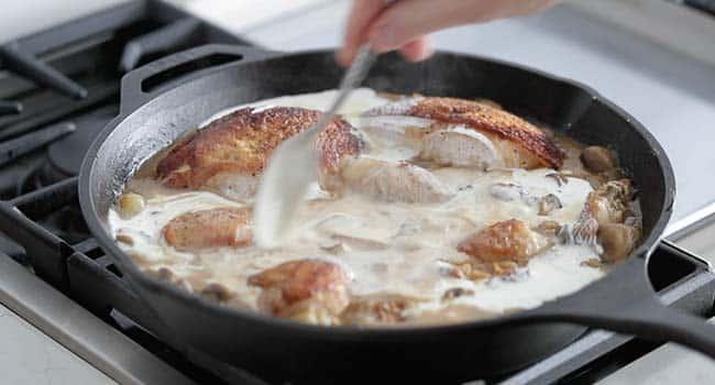 stirring cream into a chicken fricassee