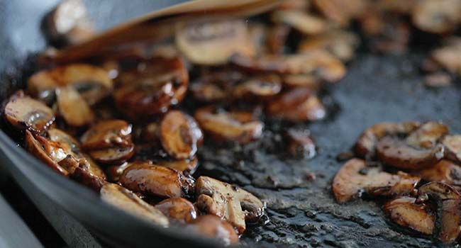 roasted mushrooms in oil in a pan