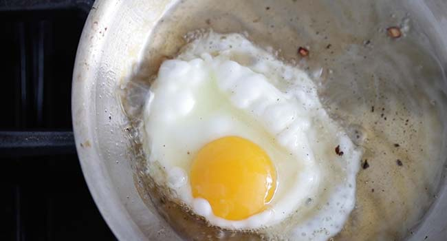 fried egg in a oil in a pan