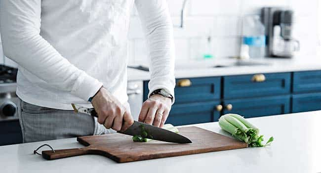 slicing vegetables on a cutting board