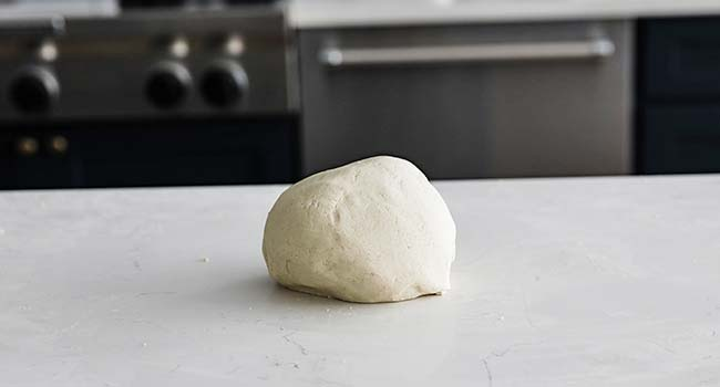 corn tortilla dough ball on a countertop