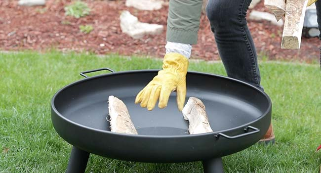 adding two logs to a fire pit