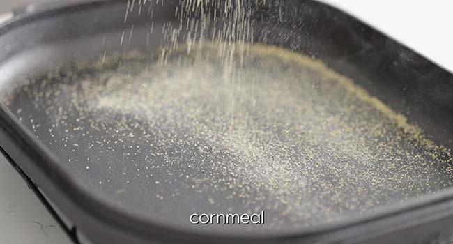 sprinkling cornmeal onto a hot preheated pan