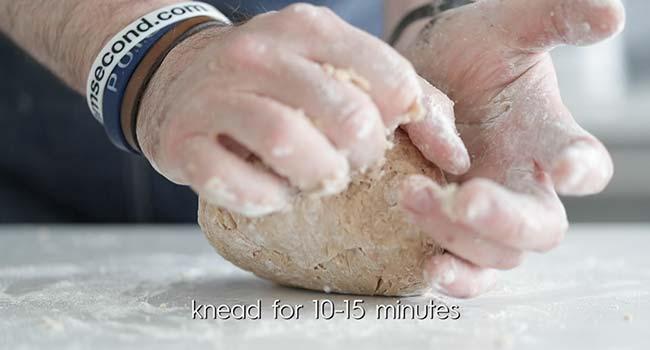 kneading cannoli dough on a clean surface