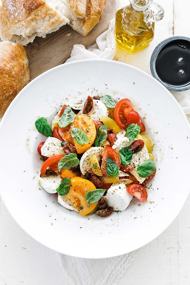tomato caprese salad in a bowl with bread