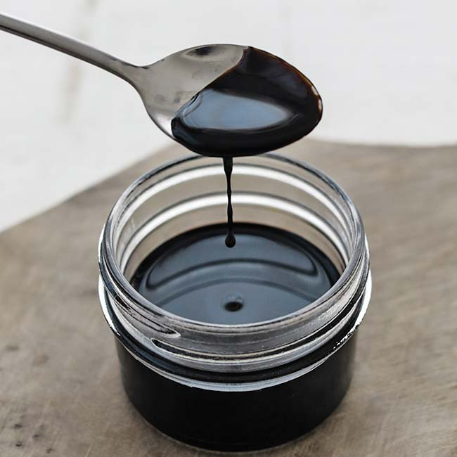 jar of reduced balsamic with a spoon