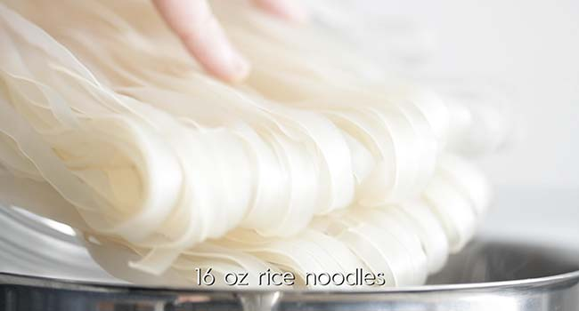 cooking rice noodles in a pot
