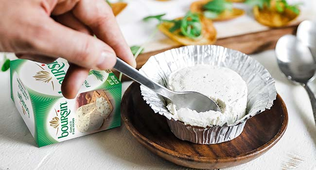 taking a scoop of boursin cheese