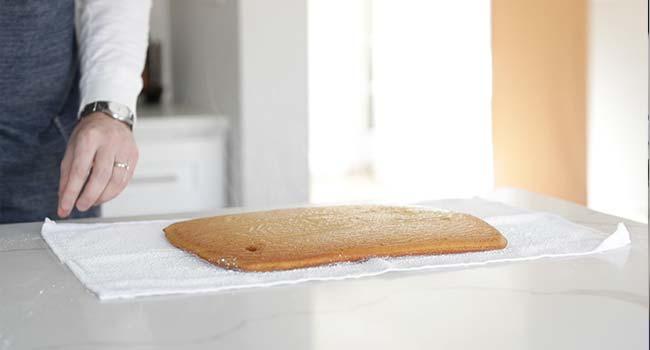 pumpkin sheet cake on a powdered sugar towel