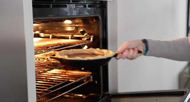 baking a pie in an oven