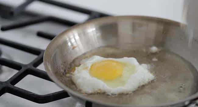 frying an egg in a pan