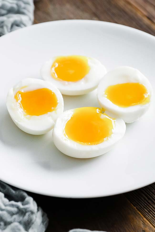 jammy soft boiled eggs on a plate