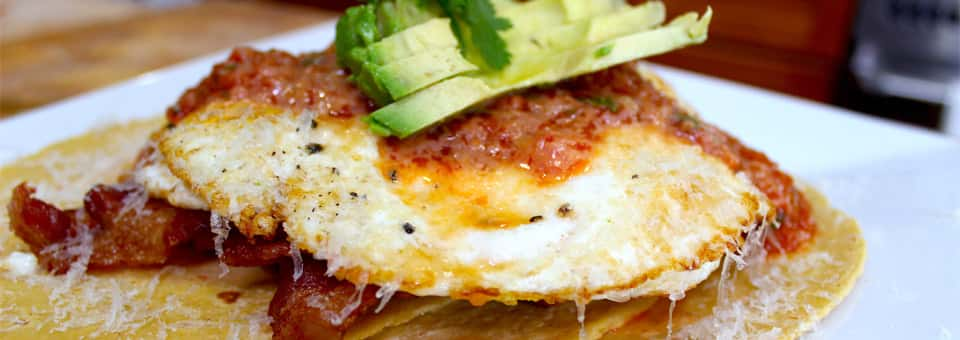 Huevos Rancheros with Avocado and Crispy Bacon
